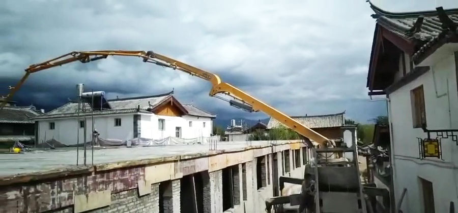 21m truck mounted boom pump in site