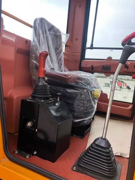 seat of the wheel loader in cab
